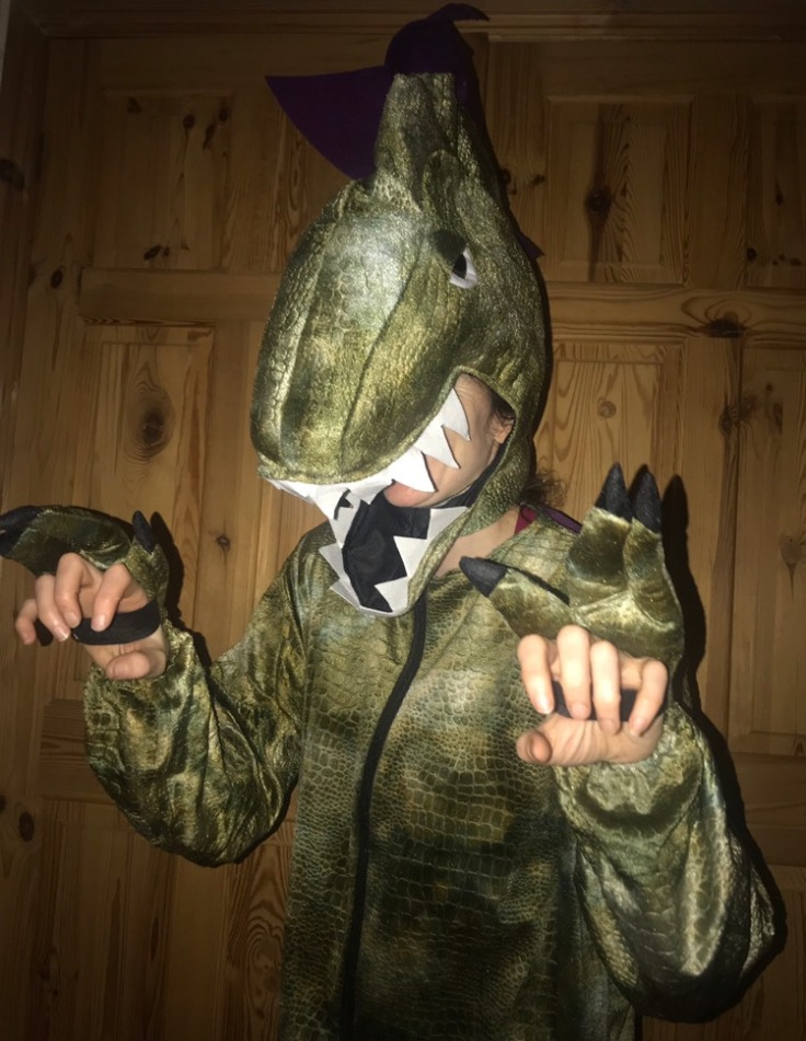 Author Lily Murray dressed as a dinosaur